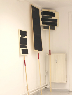 BlackOut, 2012, wood (placards) leather, velvet textiles. Gallery installation view
